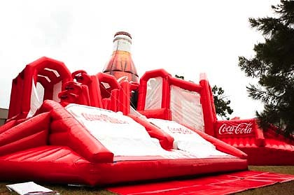 Experience the weightlessness of the giant Coca-Cola inflatable bottle.